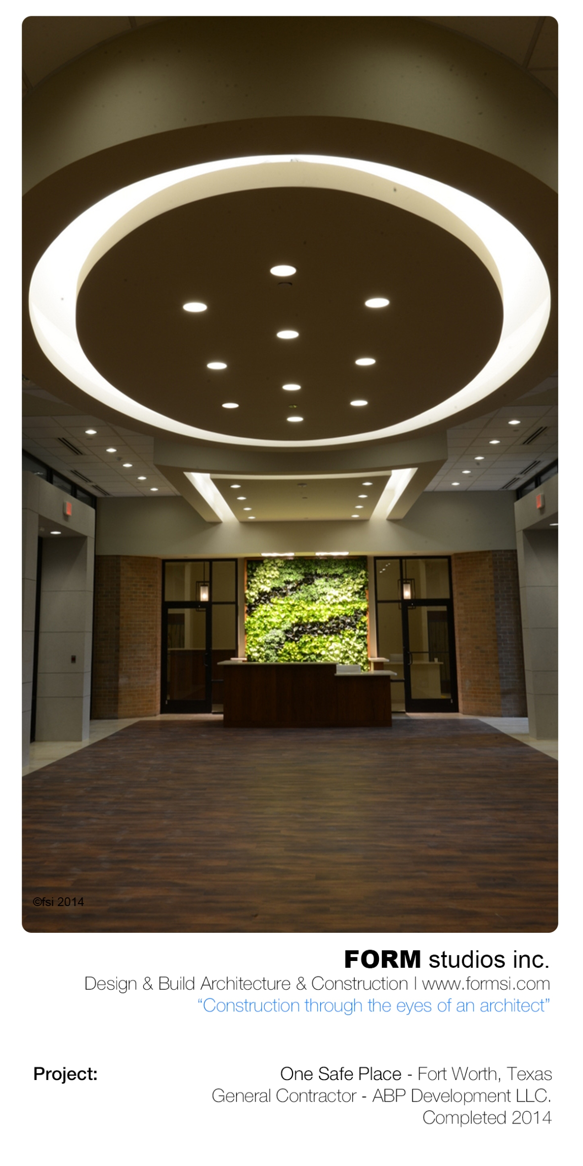 LOBBY WITH GREEN WALL AT RECEPTION