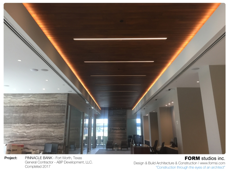 WALNUT SLAT WOOD LOBBY CEILING WITH LED COVE & SLOT LIGHTING