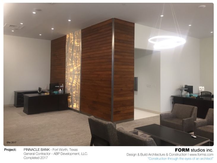 WALNUT WOOD WALL WITH ONYX INSTALLATION